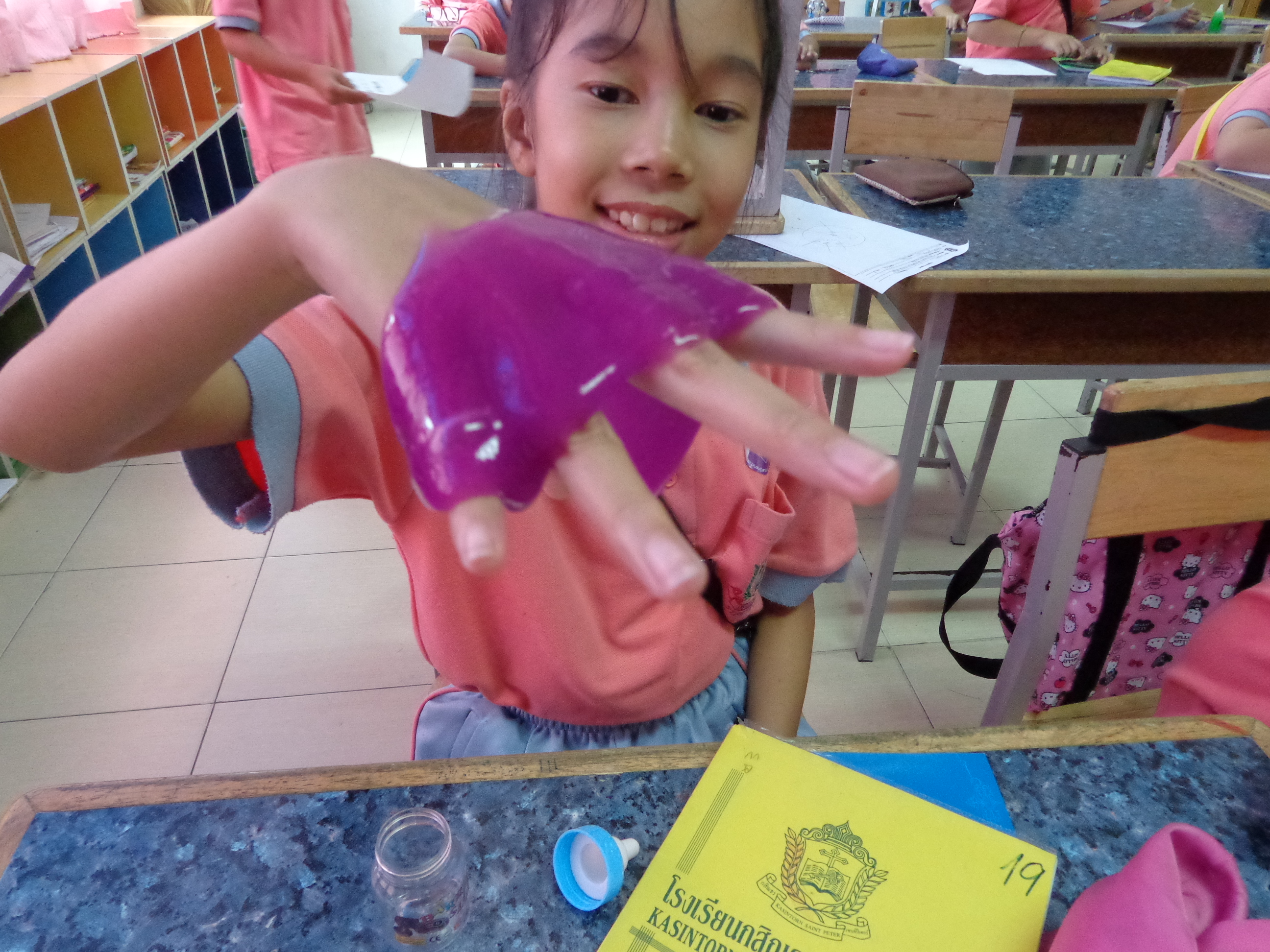My student playing with purple slime toy