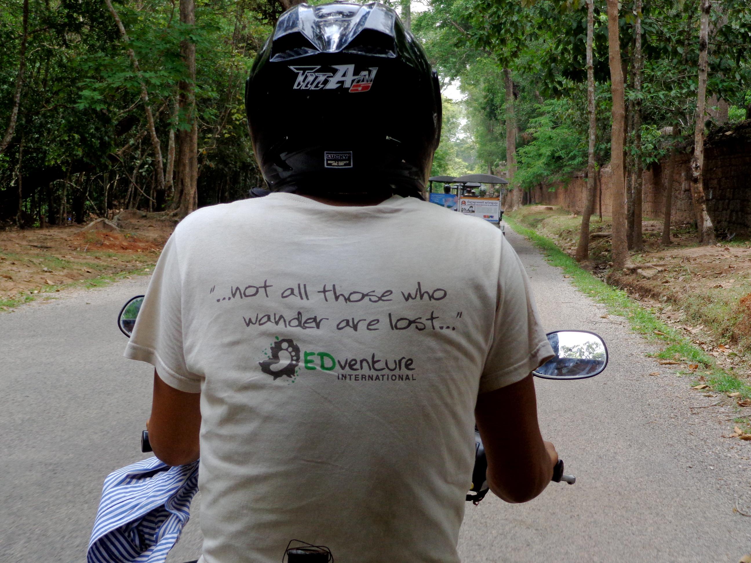 Riding in a tuk tuk through angkor wat