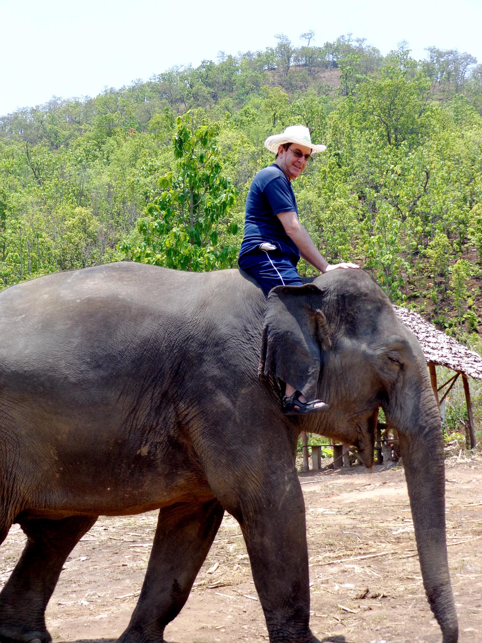 Daveo riding an elephant