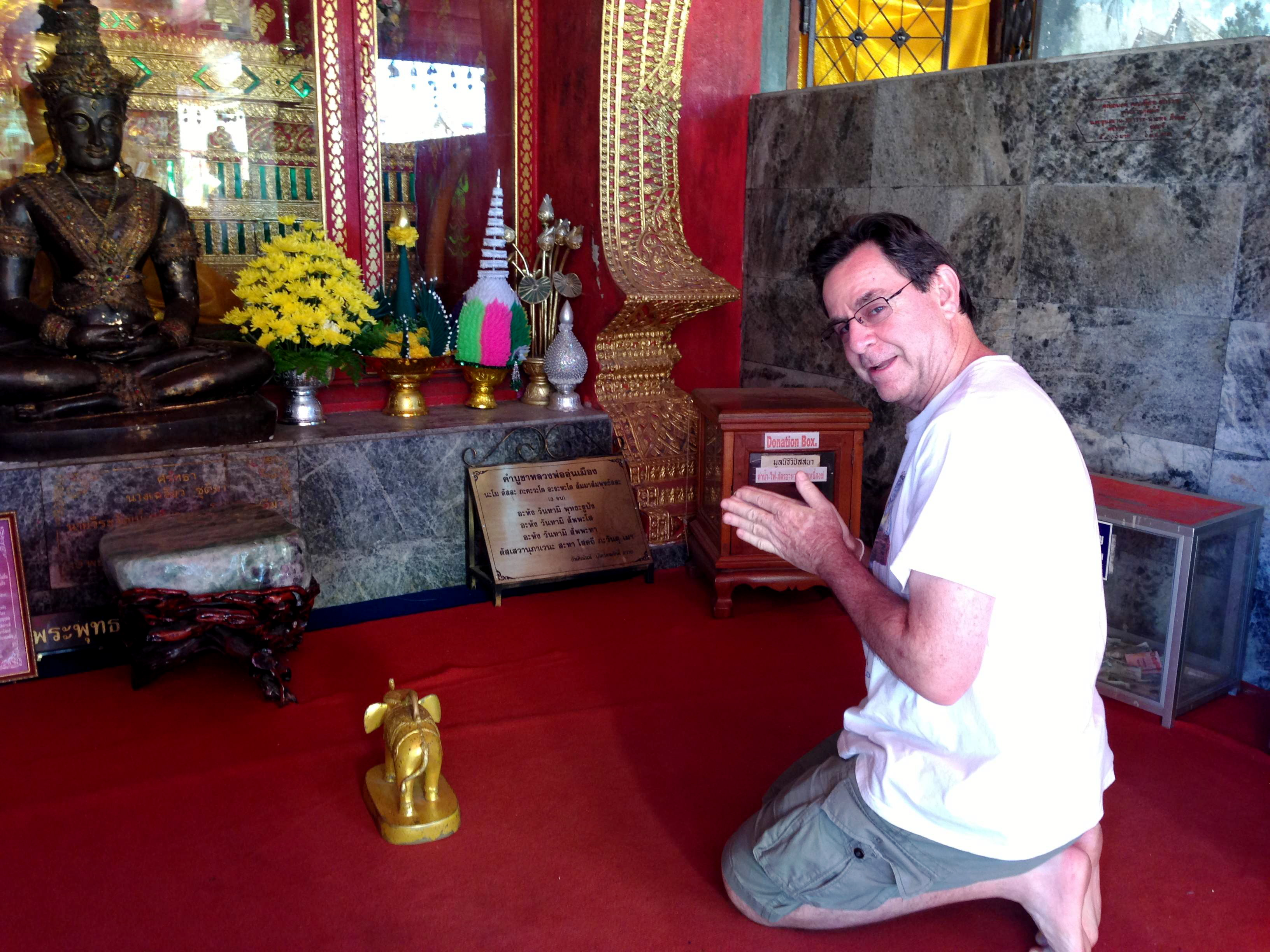 Daveo practicing his wai at Wat Doi Suthep in Chiang Mai, Thailand