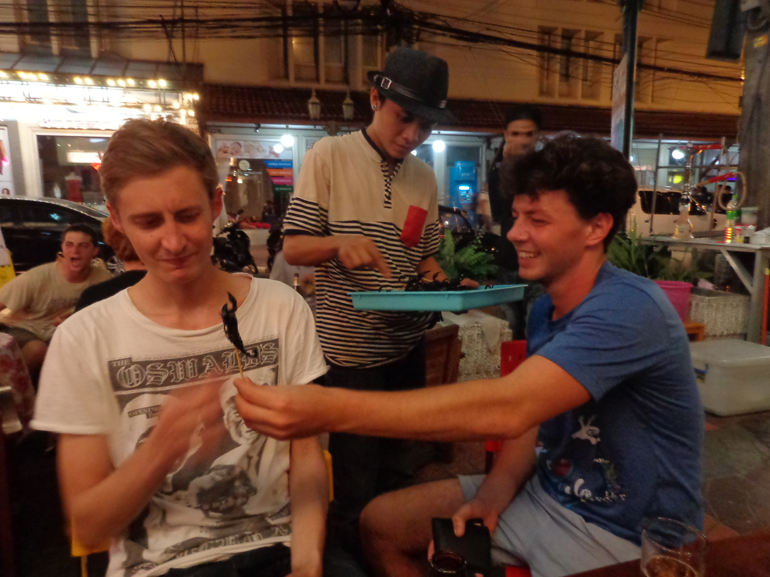 Mark and Joe trying new things on soi Rambuttri in Bangkok