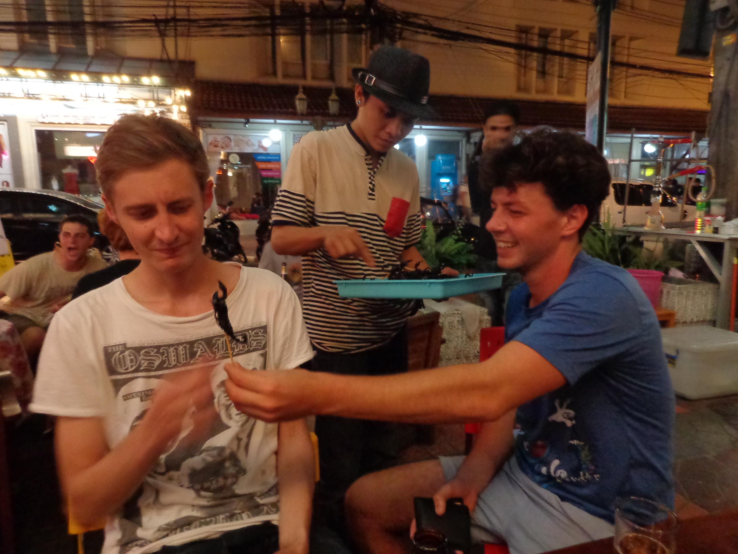 Mark and Joe trying new things on soi Rambuttri in Bangkok