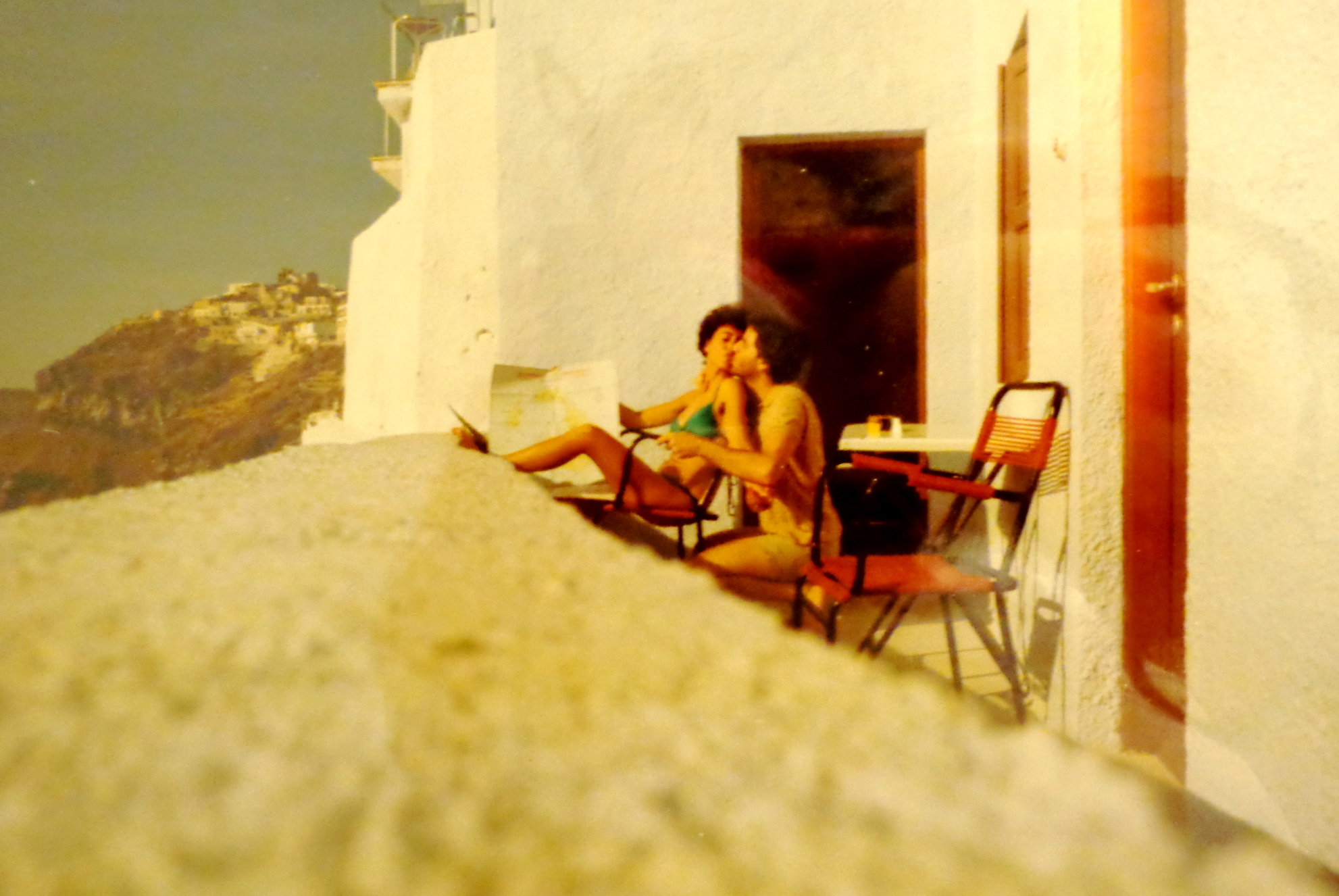My parents kissing on the balcony during their honeymoon in Greece