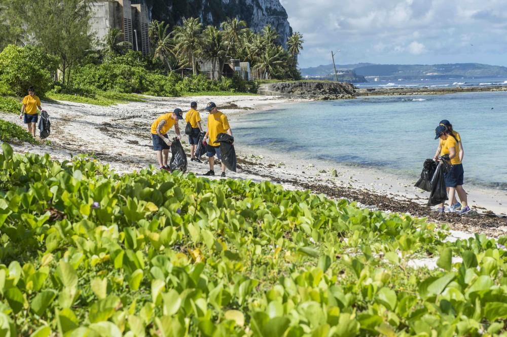 Volunteers pick up trash on beach
