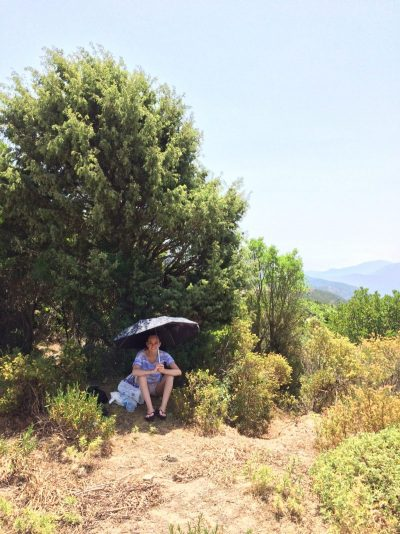 Having a roadside picnic lunch while road tripping in Sardinia