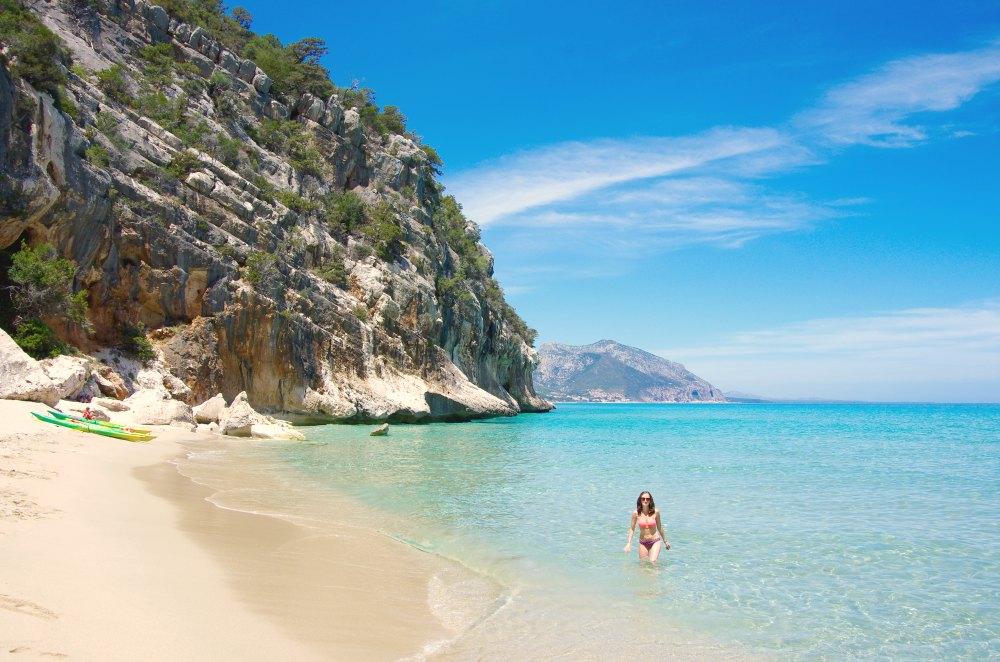 Swimming at a beach on the Golfo di Orosei in Cala Gonone