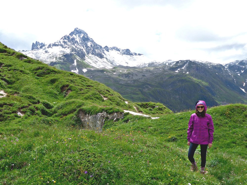 Hiking in the alps with snow capped peaks