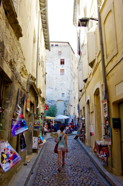 Walking through an alleyway in Avignon