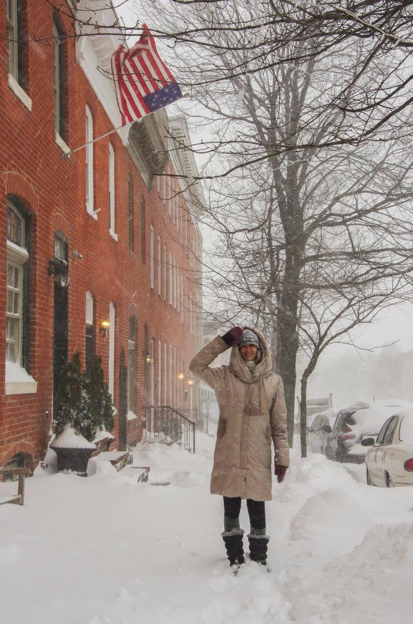 Wearing down coat in winter blizzard