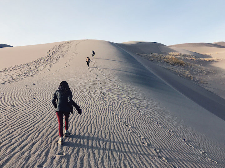 Hiking up the sand dunes at Great Sand Dunes National Park
