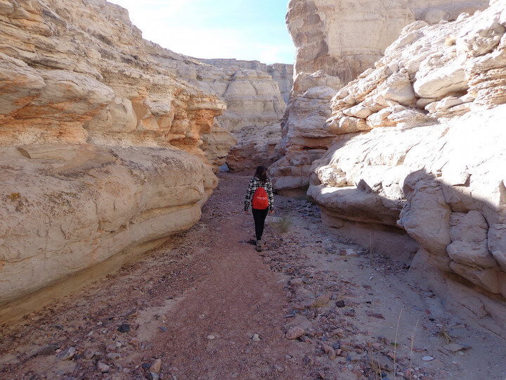 Hiking through the crevasses in Plaza Blanca, Santa Fe