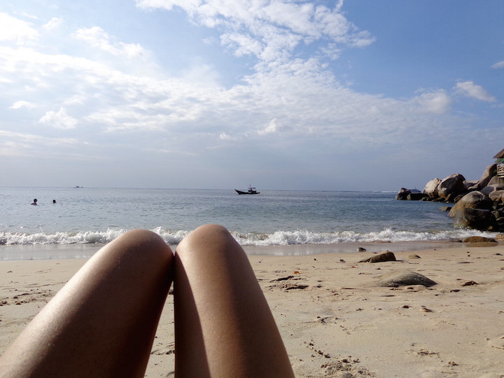 Laying out on a beach on Koh Tao