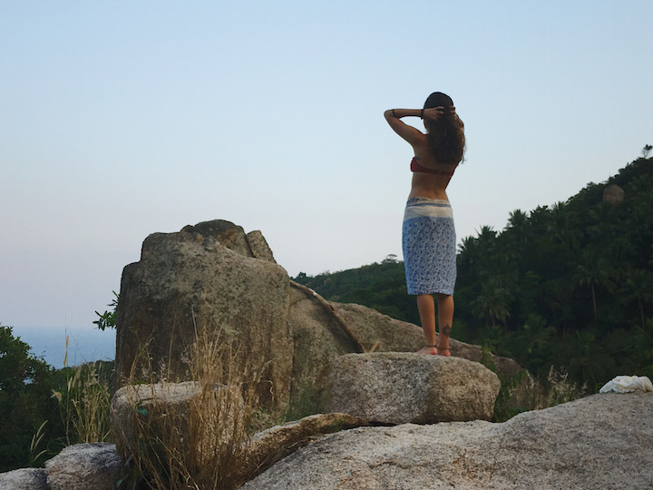 Standing on a rock overlooking the sunset on Koh Tao