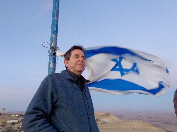 My dad on top of Har Gamal in Mitzpe Ramon with Israeli flag