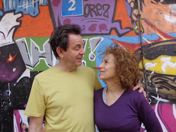 My parents in front of graffiti in Tel Aviv