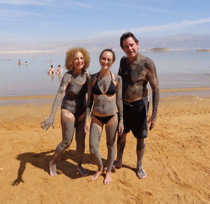 Us all covered in mud before dipping in the Dead Sea in Israel