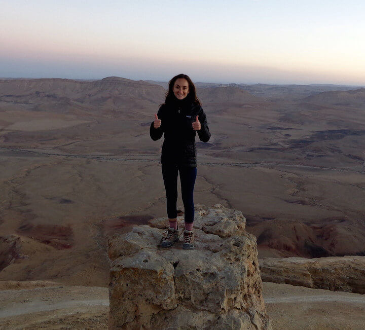 Standing on the rock at Har Gamal at sunset in Mitzpe Ramon in Israel