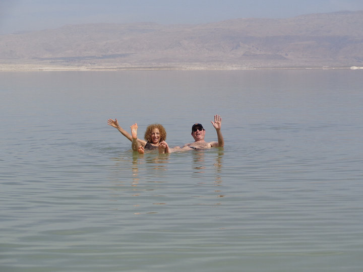 My parents floating in the Dead Sea