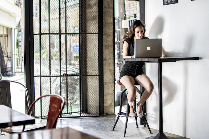 Working at laptop as a digital nomad in Koh Tao, Thailand