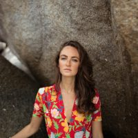Portrait in front of rocks on the beach in Koh Tao