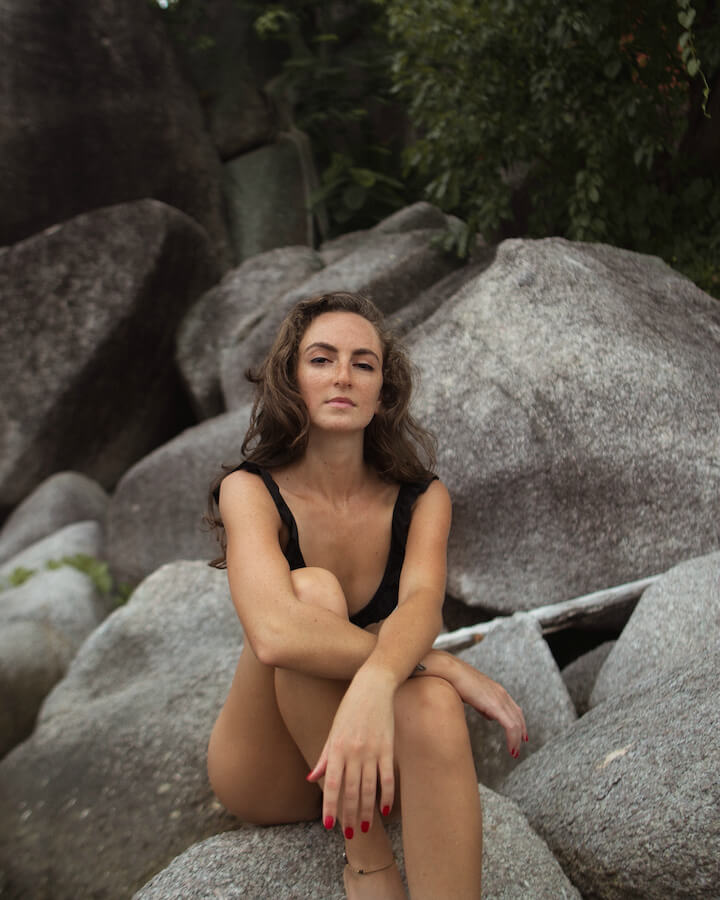 Sitting on rocks on Sairee beach in Koh Tao