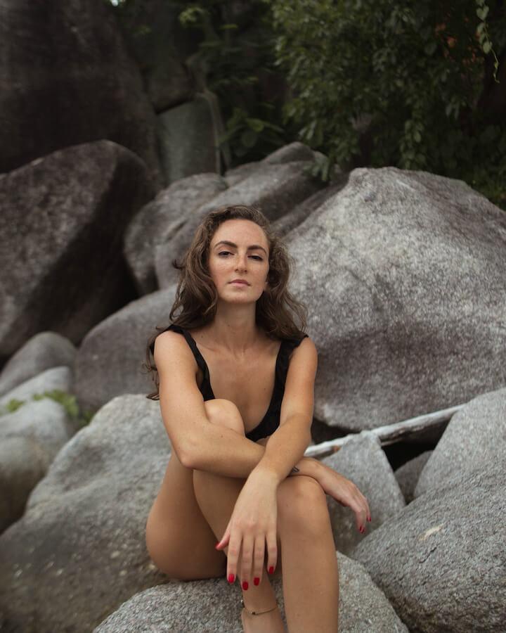 Sitting on rocks on Sairee beach in Koh Tao
