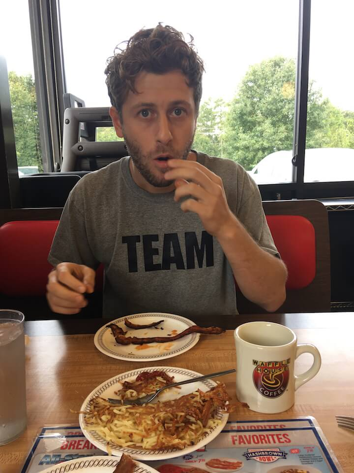 Man eating in Waffle House in Atlanta, GA