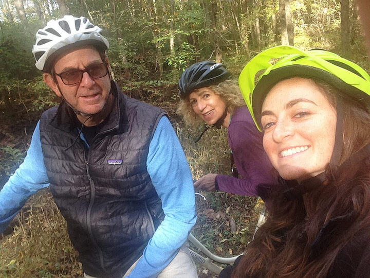 Selfie of family in helmets riding bicycles in Atlanta
