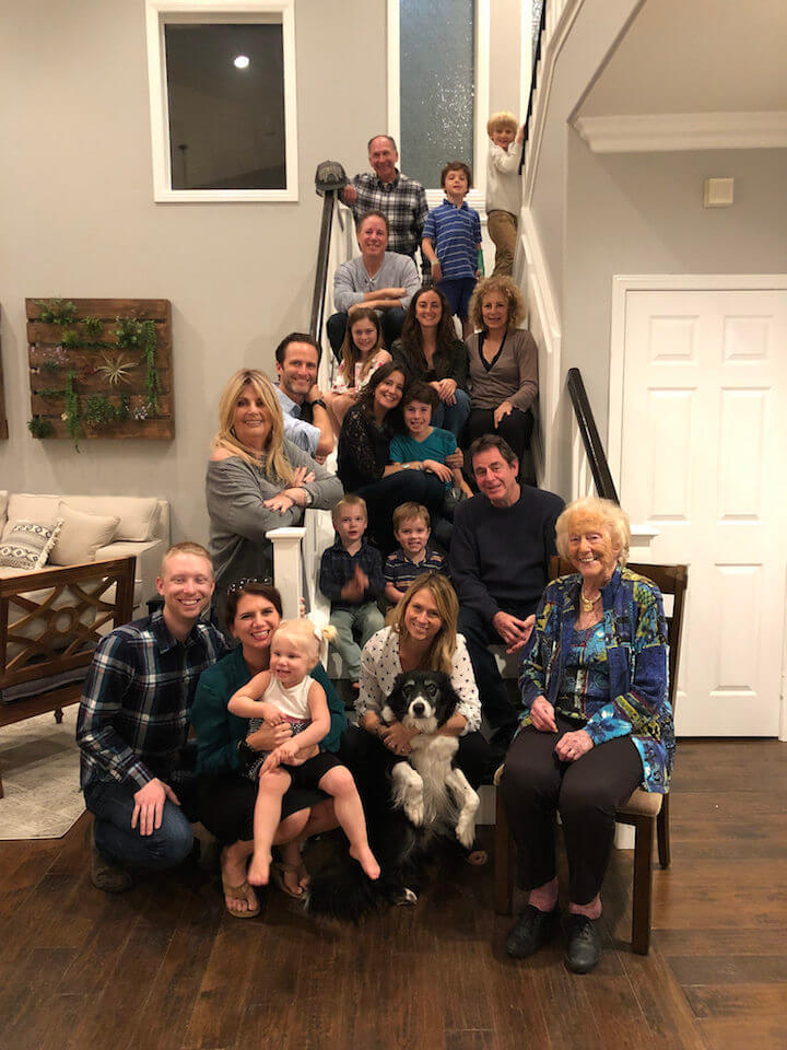 Family sitting on steps for Thanksgiving photo