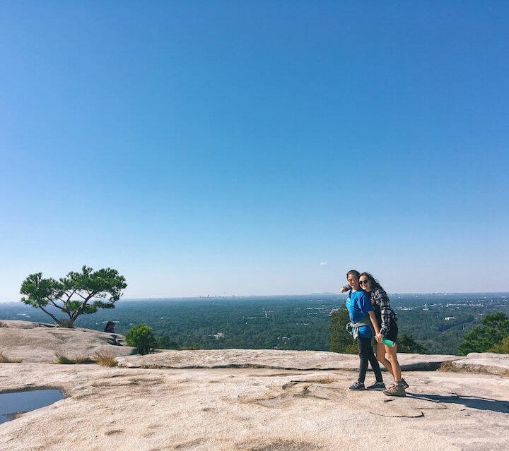 Two girls hugging on top of Stone Mountain in Atlanta
