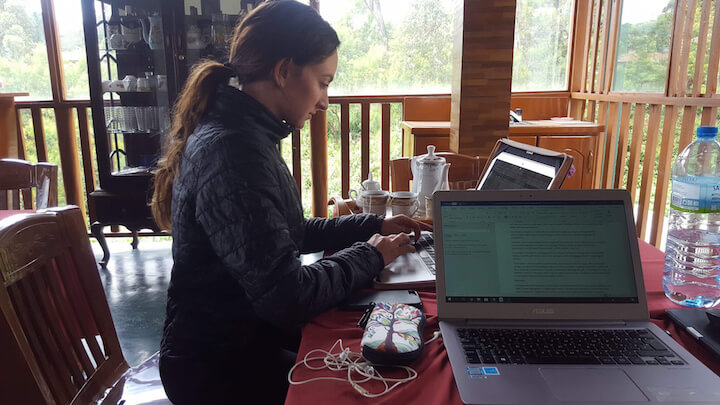 Digital nomad working on laptop in Nuwara Eliya, Sri Lanka