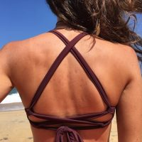 Girl's upper back in bikini on beach