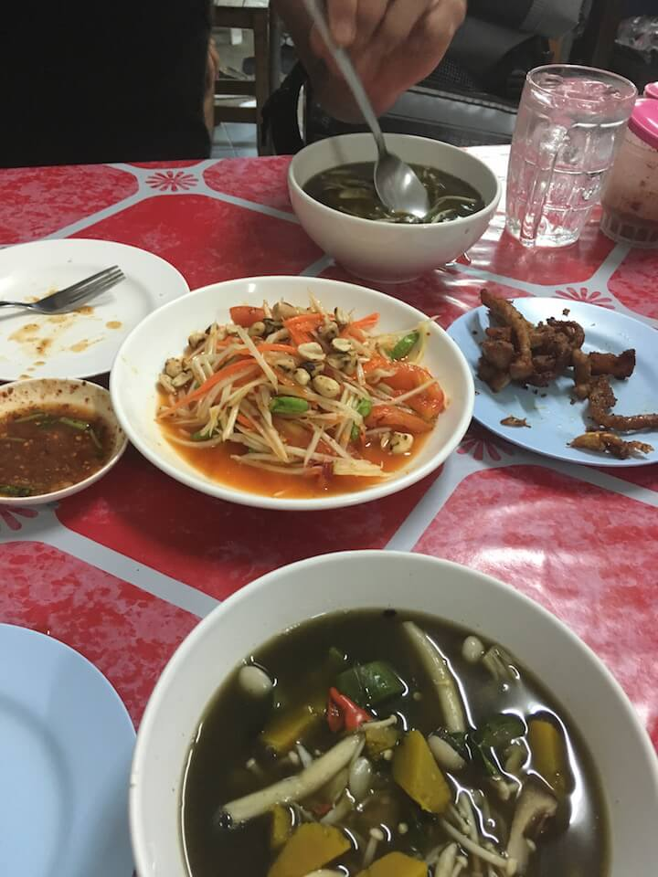 Gaeng hed or mushroom soup with som tam in Thailand