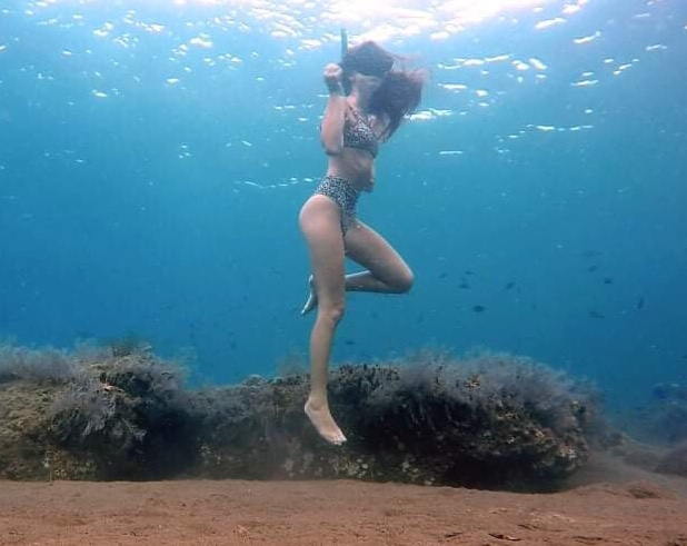 Girl freediving in Amed, Bali