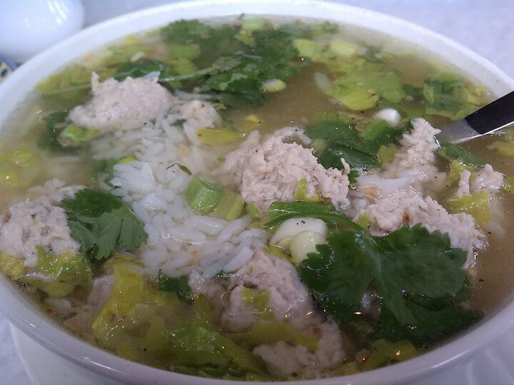 Khao tom gai or chicken and rice soup