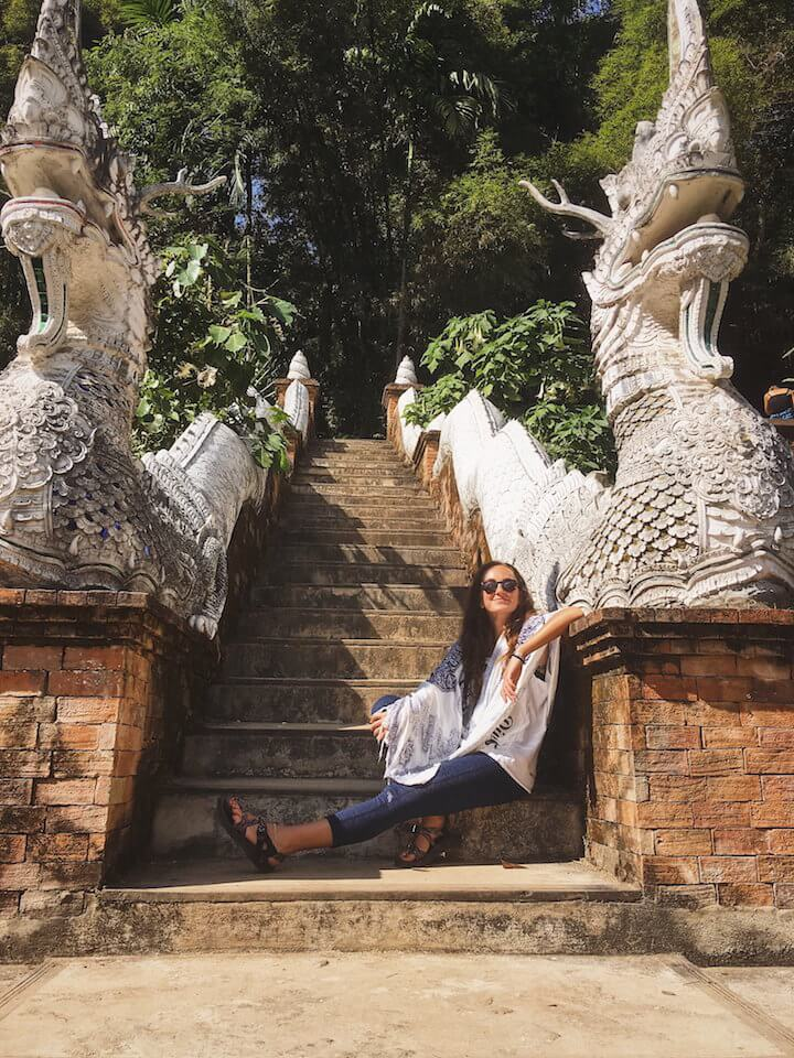 Sitting at wat at the summit of Monk's Trail in Chiang Mai