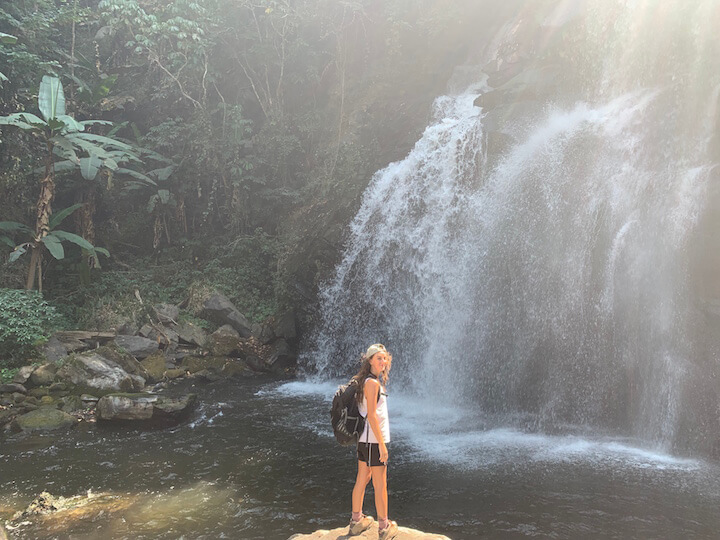 Standing in front of a waterfall in Doi Inthanon National Park