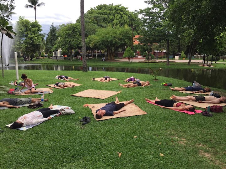 People doing yoga in the park in Chiang Mai