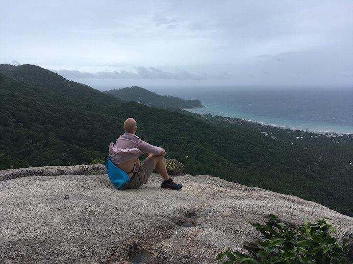 Man sitting on rock overlooking Koh Tao, Thailand