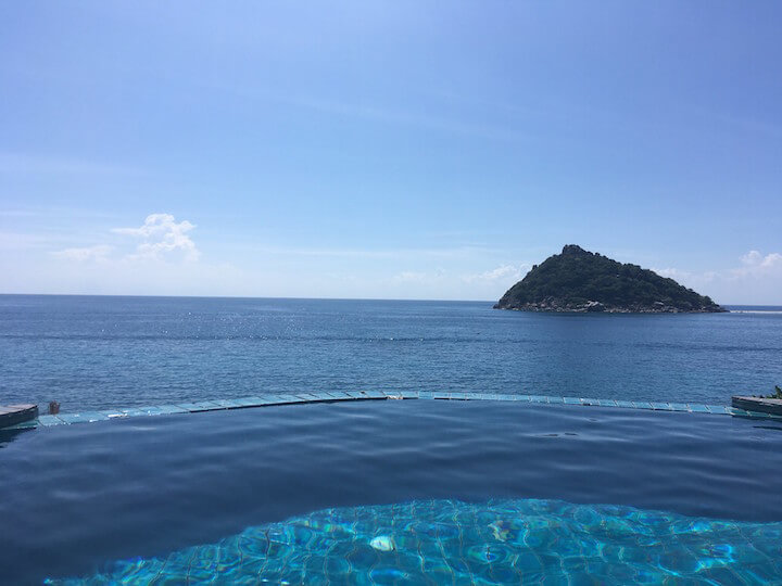Infinity pool over the sea in Koh Tao with Nang Yuan in the distance