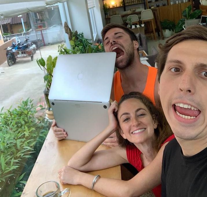 Two boys and a girl digital nomads being silly while working online