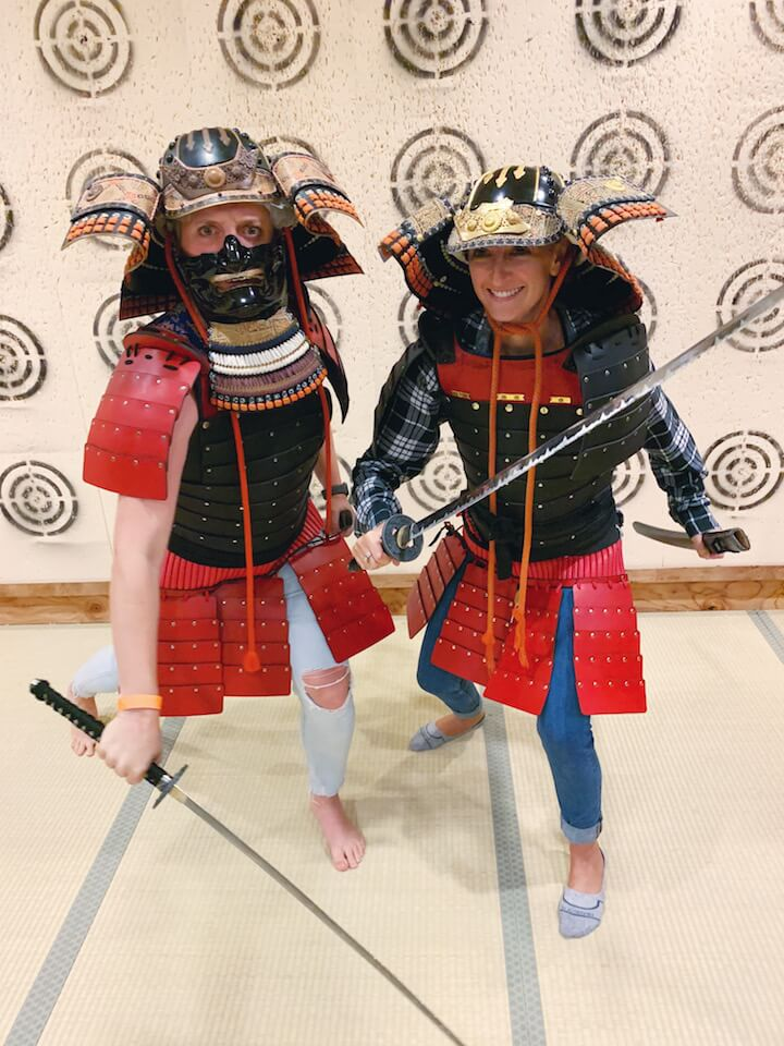 Girls dressed up in samurai armor at ninja and samurai museum in Kyoto