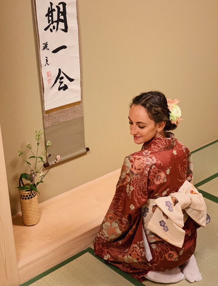 Woman in kimono sitting on the floor at tea ceremony in Kyoto