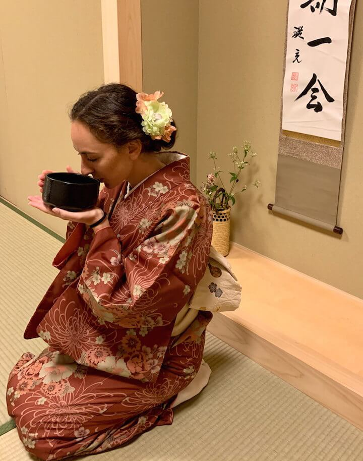 Woman drinking matcha at Maikoya tea ceremony in Kyoto