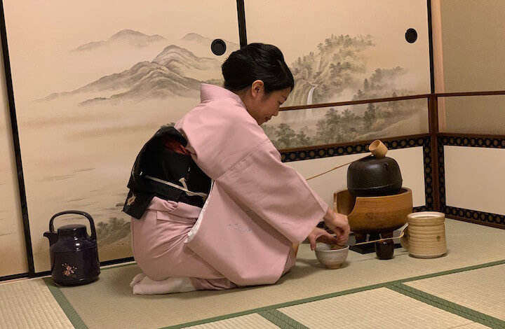 Tea master preparing tools for tea ceremony at Maikoya in Kyoto