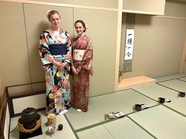 Two girls in kimonos at tea ceremony in Kyoto, Japan