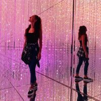 Girl in pink LED light room at teamLab Borderless Tokyo