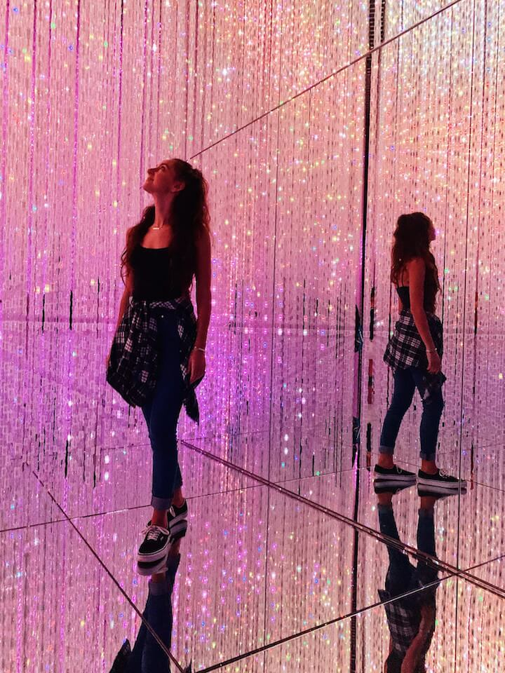 Girl in pink LED light room at teamLab Borderless Tokyo