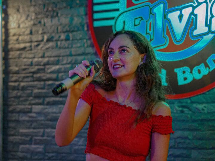 Girl singing karaoke in Chiang Mai
