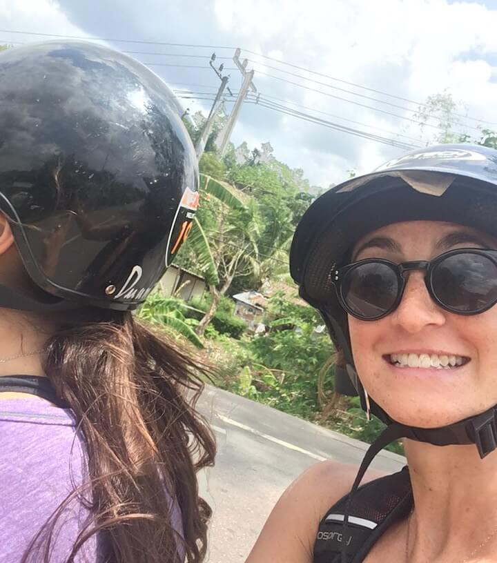Digital nomad travelers riding a scooter in Thailand